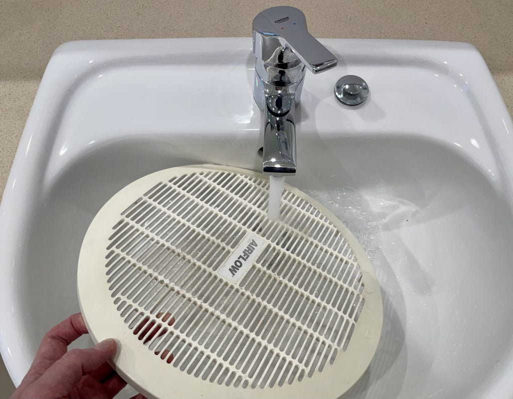 clean bathroom extractor fan cover
